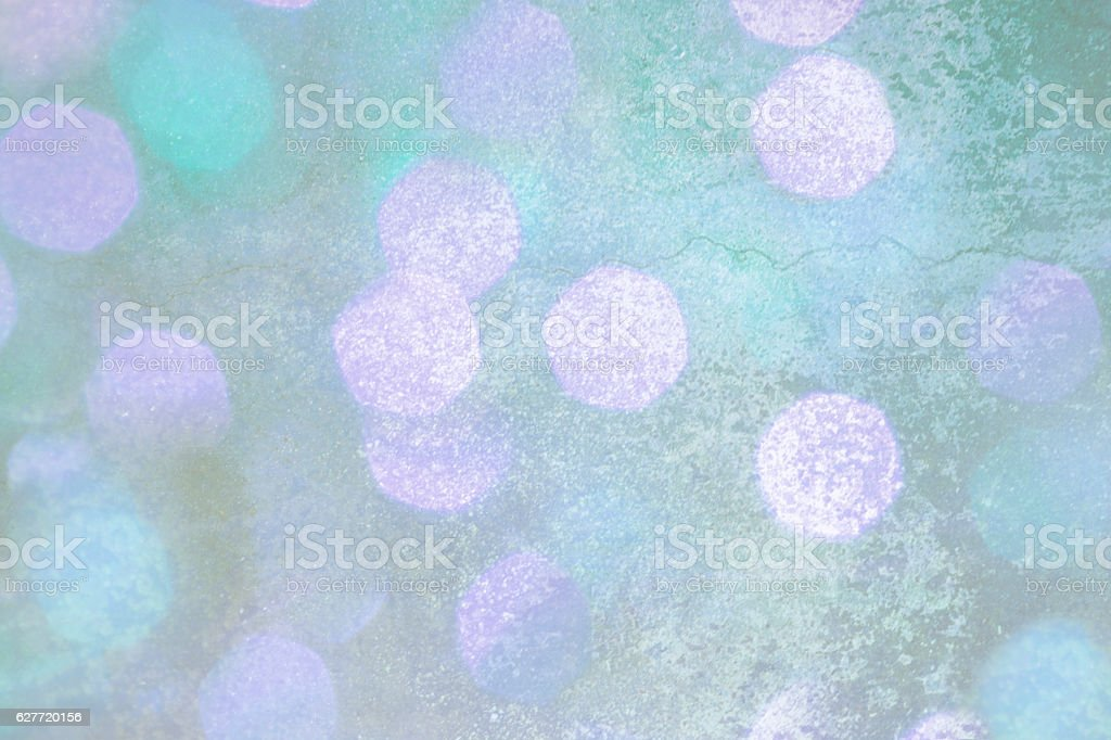 Winter, Christmas background of pastel lights on textured surface. stock photo