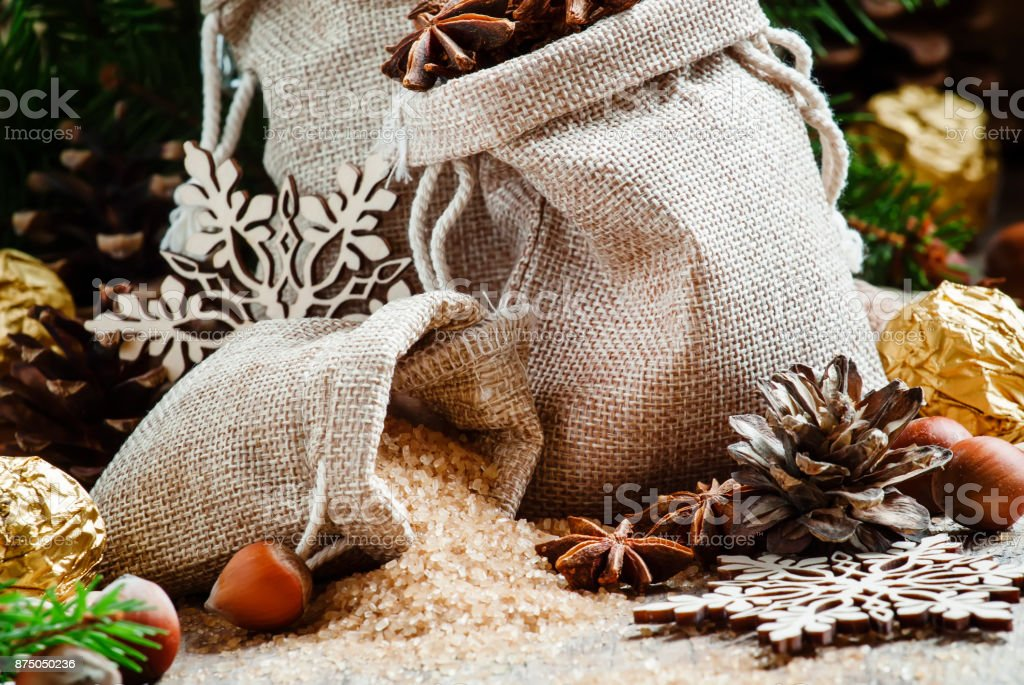 Winter Christmas spices, candy and nuts stock photo