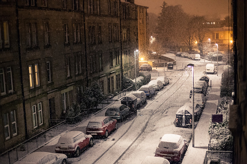 Winter city street in the night under the snow in UK