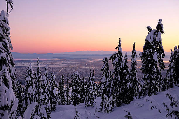 Winter city view from mountain in sunrise. – Foto