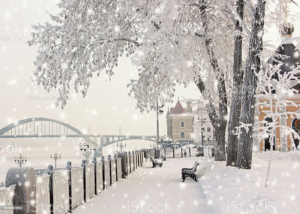 Winter cityscape with snow falling. Rybinsk. stock photo