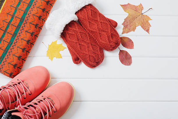 winter clothes and shoes on a wooden background - damenschuhe k stock-fotos und bilder