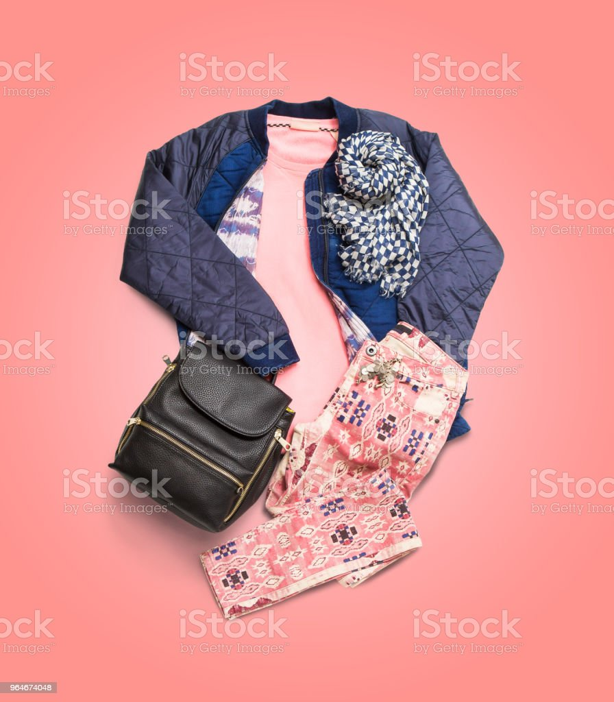 Winter clothes collection on pink gradient background royalty-free stock photo