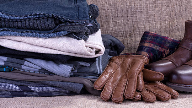 winter clothes - warm clothing stock photos and pictures