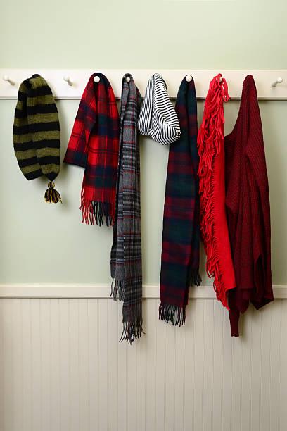 winter kleidung in mudroom - garderobenhaken stock-fotos und bilder