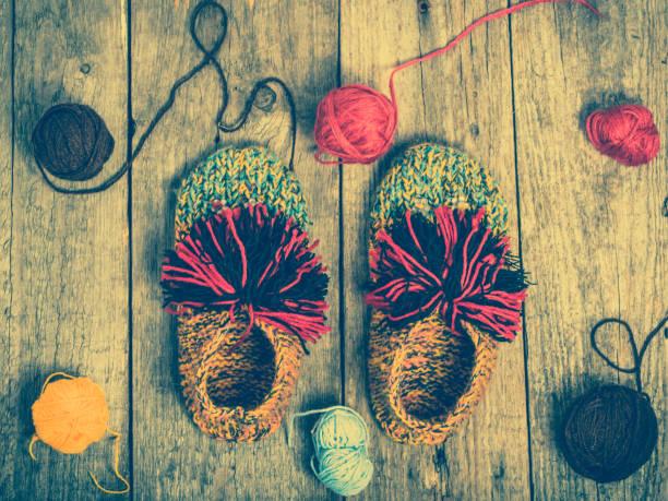 winter clothing, shoes from wool, woolen clothes concept - babyschuhe nähen stock-fotos und bilder