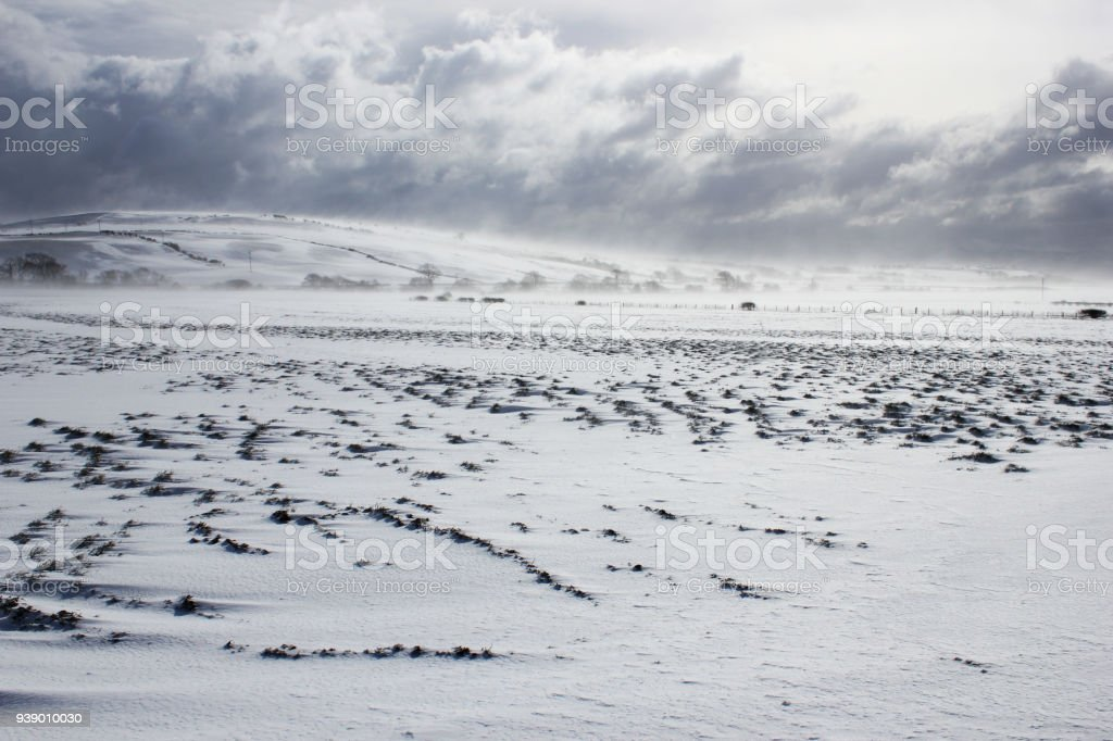 Clouds gathering over a snow covered landscape, Isle of Bute,...