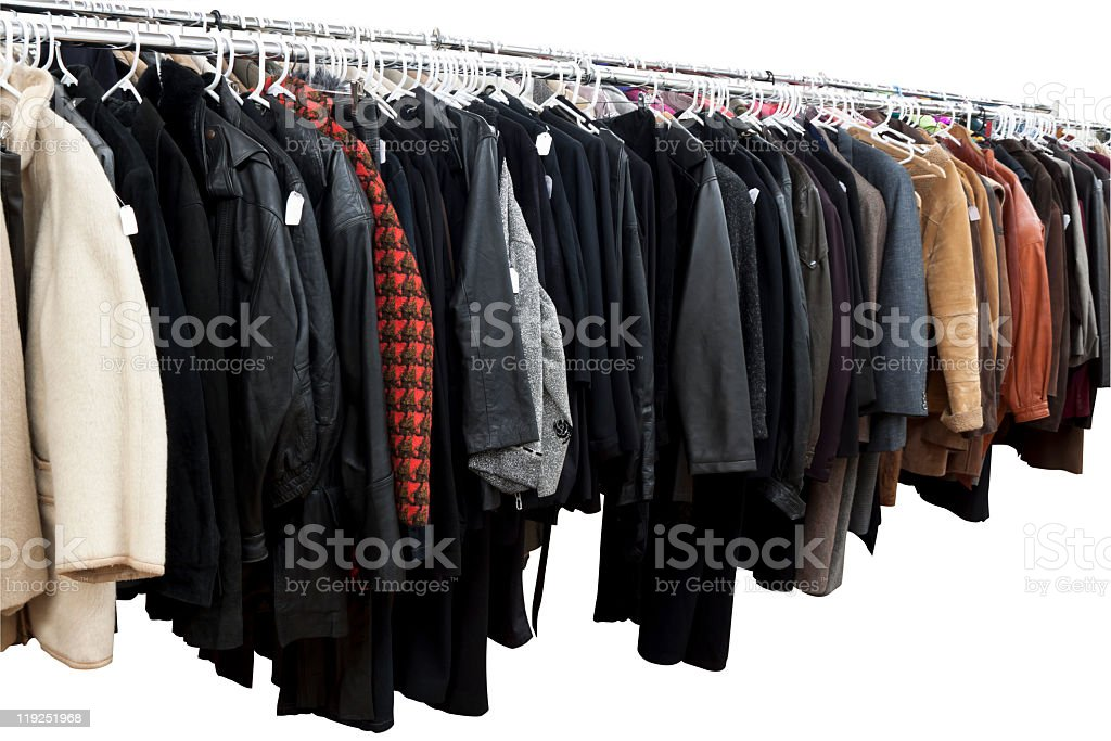 Winter Coats and jackets on rack isolated on white background stock photo