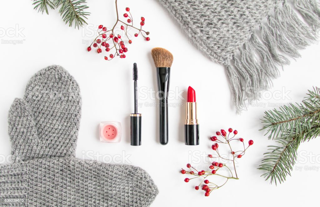Winter collage with cosmetics and clothes on white. Flat lay stock photo