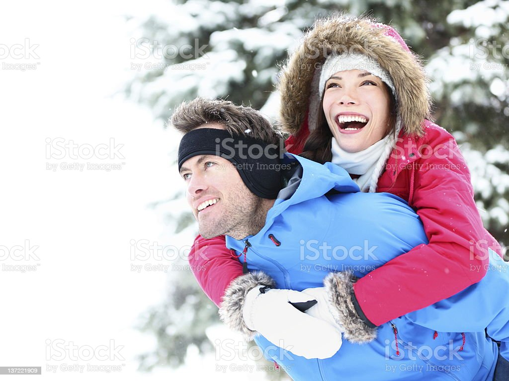 Winter couple happy piggyback royalty-free stock photo