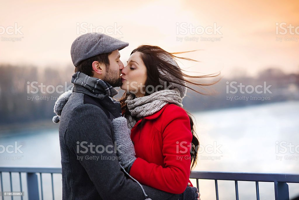 Winter couple kissing stock photo
