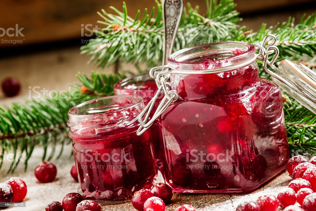 Winter cranberry sauce in glass jars stock photo