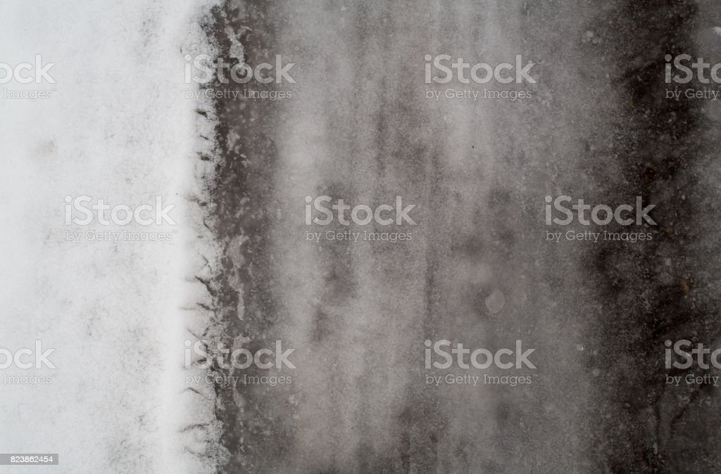 Winter dark melted snow background royalty-free stock photo