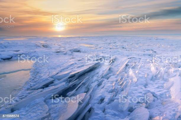 Photo of winter dawn on the frozen lake