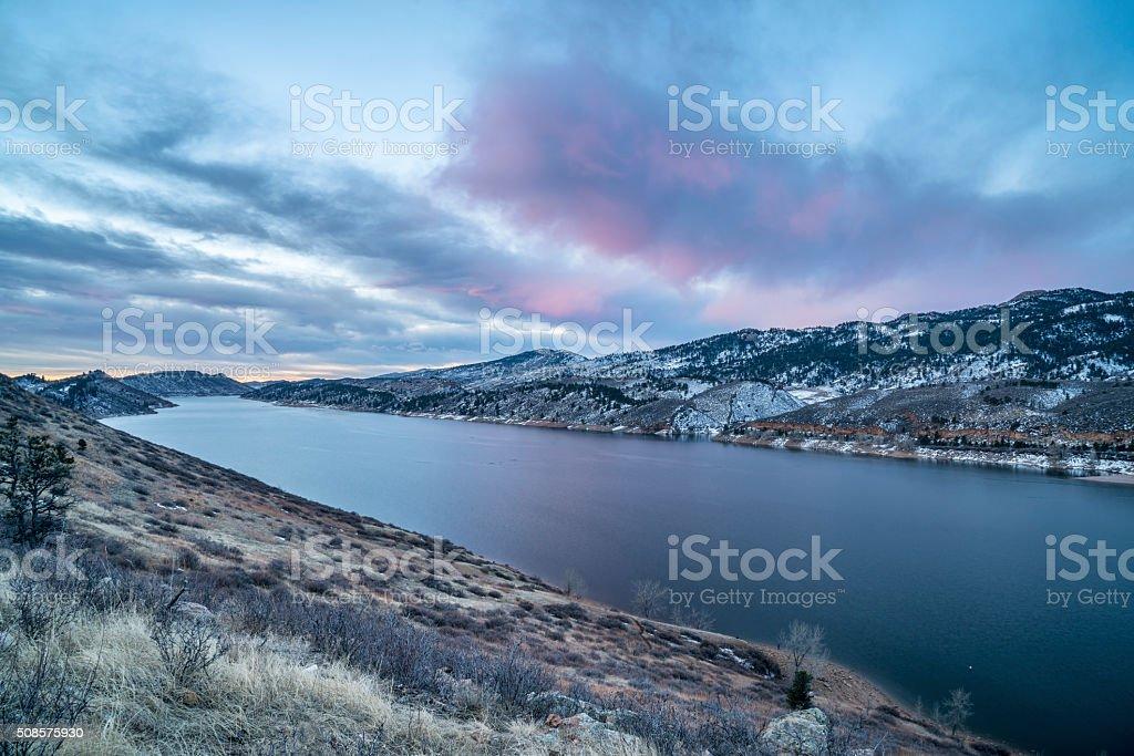 winter dawn over mountain lake stock photo