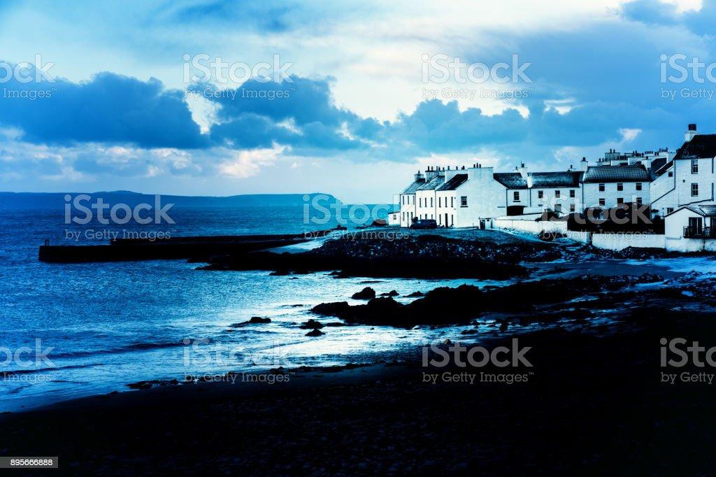 Winter dawn over Port Charlotte, Islay, Scotland stock photo