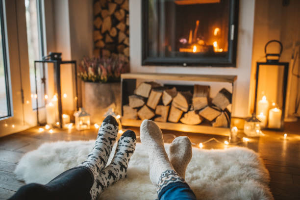 Winter day by fireplace Lazy winer day in front of fire in fireplace. cozy stock pictures, royalty-free photos & images