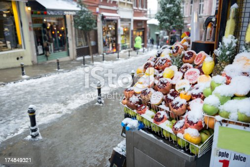 Fresh fruit on a stand, covered in snow on a grey winter day in Istanbul, TurkeyMore of my images from Turkey: