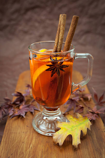 Winter drink Cozy winter drink mulled with spices hot apple cider stock pictures, royalty-free photos & images