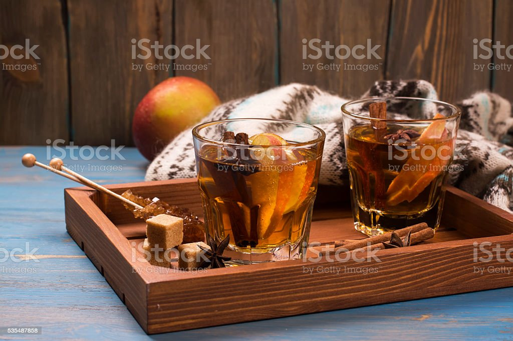 Winter drink. Warm mulled apple cider with spices stock photo