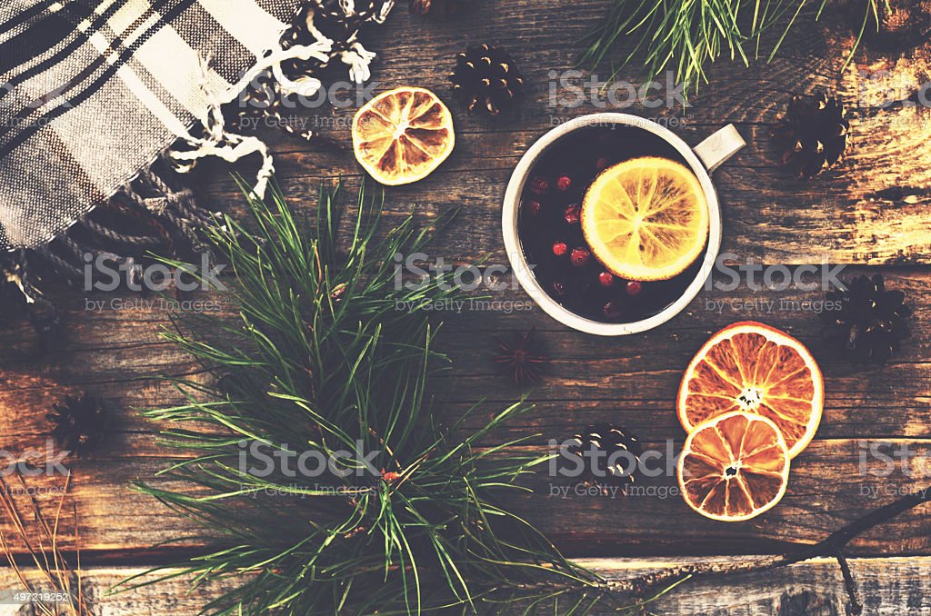 Winter drink with lemon, cranberries and spices stock photo