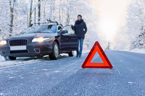 winter driving - car breakdown stock photo