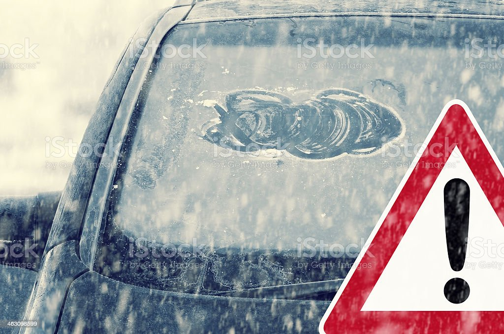 winter driving - careless ice removal stock photo