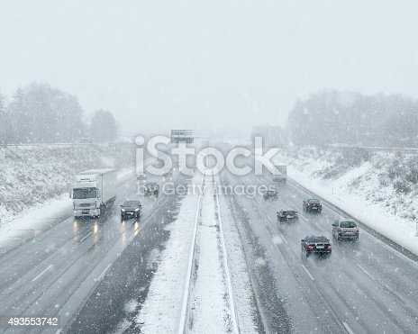482803237 istock photo Winter Driving - Commuter Traffic 493553742