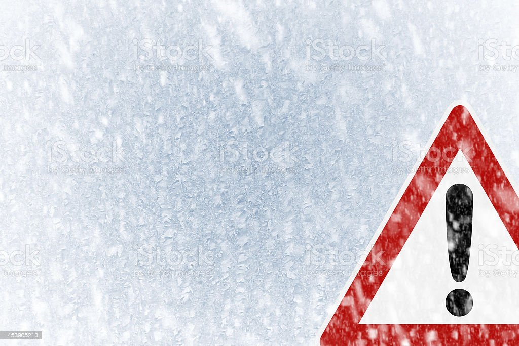 Winter driving -  ice covered windshield with copy space stock photo