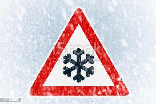 482803237 istock photo Winter driving - ice covered windshield with warning sign 454138861