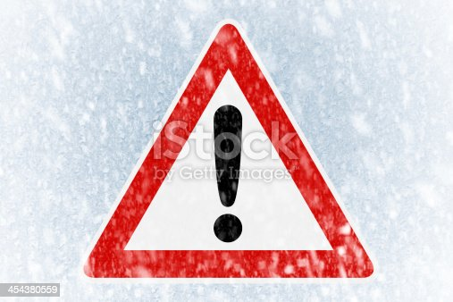 482803237 istock photo Winter driving - ice covered windshield with warning sign 454380559