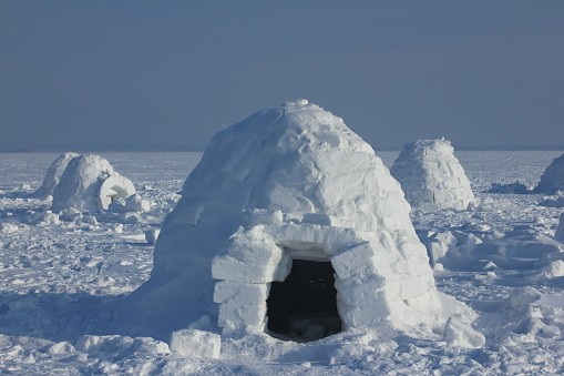 Winter dwelling of Eskimos. Igloo.  Eskimos village.