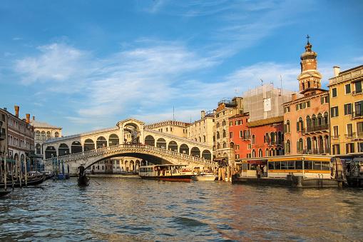 Venice, Italy - February 28, 2012: Winter evening. The symbol of the city is the ancient Rialto Bridge ( Ponte di Rialto) over the Grand Canal.