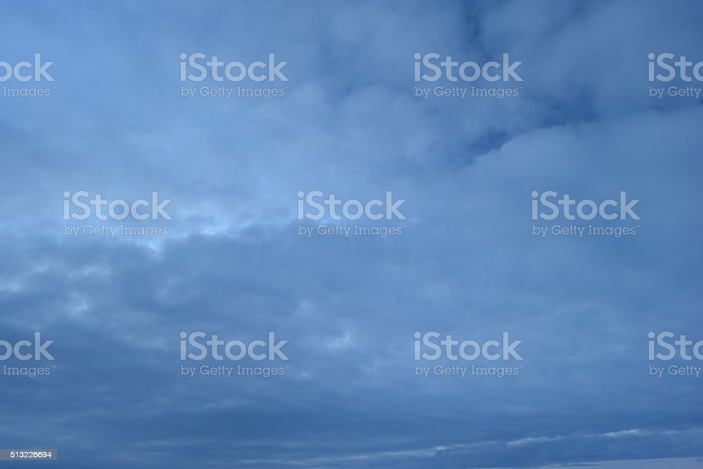 Winter evening sky in a cloud of light gray clouds