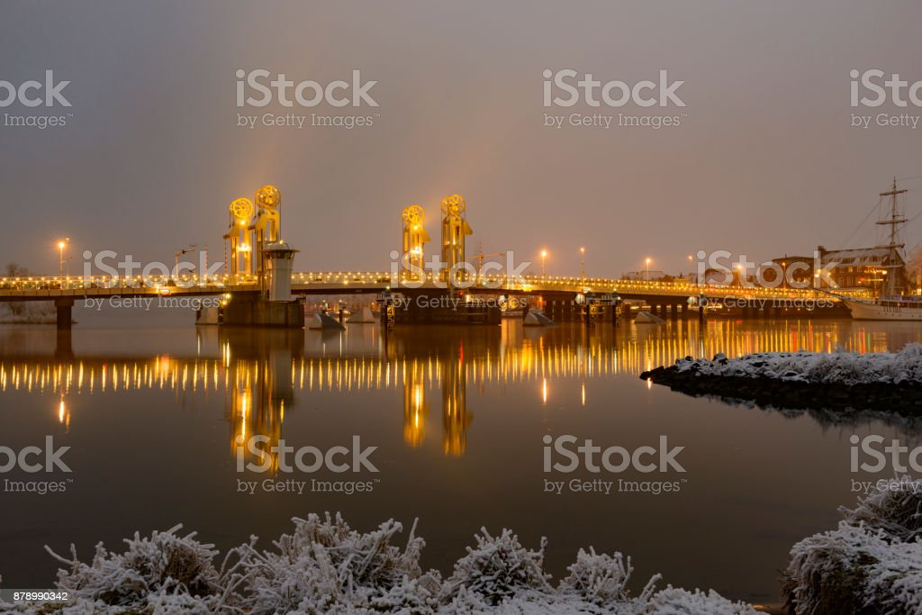 Winter evening view on the city bridge in Kampen in Overijssel, The Netherlands stock photo