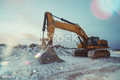 Excavator on a Winter construction site.