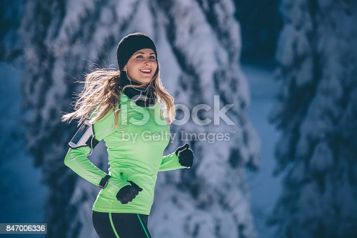 Women on snowy mountain exercising