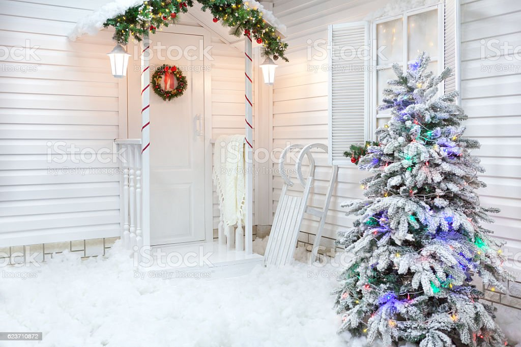 Winter exterior of a country house with Christmas decorations stock photo