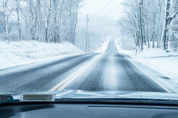 Winter Extreme Weather Blizzard Snow Rural Highway Hill stock photo
