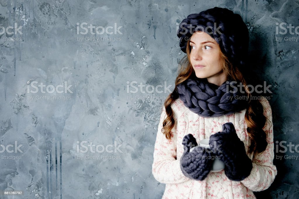 6a1decd9f4ed4 Winter fashion accessories.Young woman dressed for cold weather in grey  snood