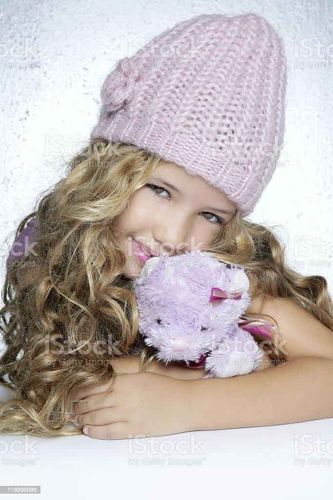 winter fashion cap little girl hug teddy bear smiling royalty-free stock photo