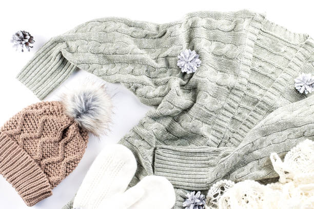 Winter fashion concept flat lay. Warm, cozy winter clothing, Christmas decorations on white background Winter fashion concept flat lay. Warm, cozy winter clothing, Christmas decorations on white background, top view warm clothing stock pictures, royalty-free photos & images