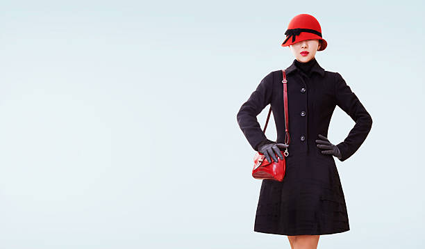 winter fashion look. red hat,purse, and black coat isolated. - オーバーコート ストックフォトと画像