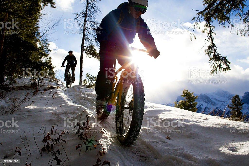 Winter Fat Bike Riders stock photo