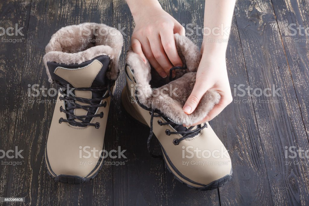 Winter female boot with fur over white stock photo