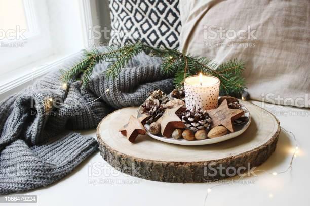 Winter festive still life scene burning candle decorated by wooden picture id1066479224?b=1&k=6&m=1066479224&s=612x612&h=j8uzh2x4zevvwmvupaxdga8rn6mmbxpbbqqrwzposc4=
