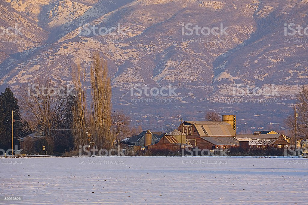Winter Field and Mountains with Barn 1 royalty-free stock photo
