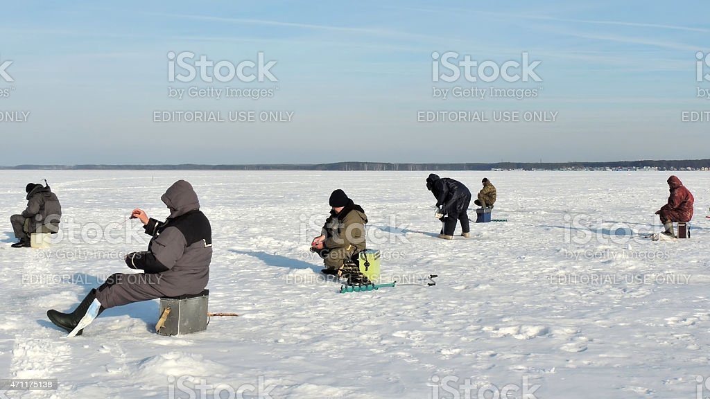 Winter fishermen on river ice stock photo