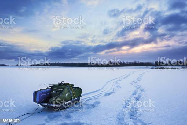 Photo of Winter fishing sled with equipment for ice fishing