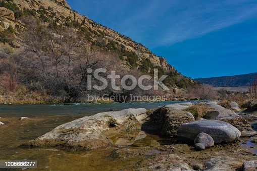 A high definition photo of a man on the Sna Juan River in the winter.